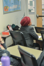 Student listens to Peter Tinti speak about migrant smugglers