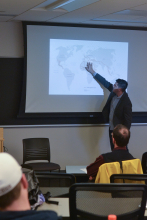 Peter Tinti gives a lecture to students and professors about profits of hope and their impact on the world