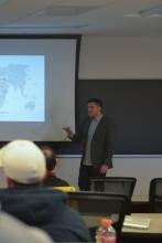 Peter Tinti gives a presentation about criminal entrepreneurs