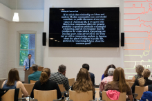 Students and faculty listen to Caleb Elfenbein's presentation on Debating the Common Good: Islam, Social Theory, and the Ethics of Cross-cultural Analysis - Lehigh University